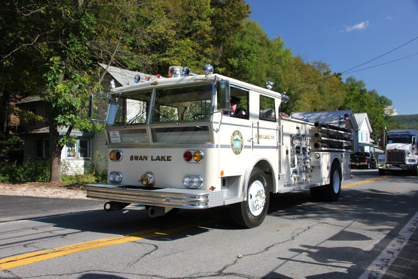 Swan Lake Fire Department's white fire truck really stood out on Grahamsville's Main Street.