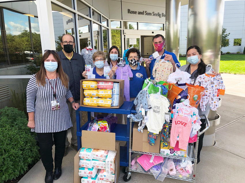 Pictured with the baby items are from left: Chief Nursing Officer Suzanne Lange Ahmed, Monticello Kiwanians President Marvin Rappaport and Sheila Lashinsky, Director of Obstetrics Toni Duncan, Woodridge Kiwanians Sue Kasofsky and Patrick Smith and Obstetrical Dept. RN Katie Parckys.