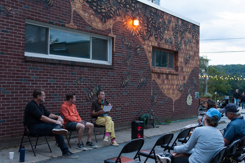 Mark Randall, Owner of B-Line Ice Cream, Mural Artist Matt Willey, The Good of the Hive, and Producer/Director Mathew Schmid, Tree Media, take some questions from the crowd about the importance of bees and pollinators in our community.