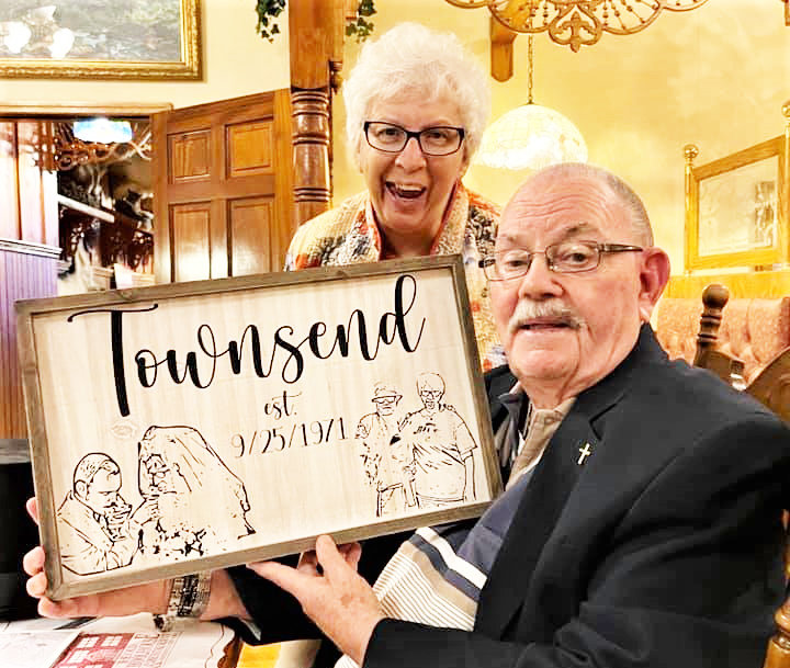 Ed and Shirley Townsend admire this plaque given to them for their 50th Golden Wedding Anniversary by granddaughter Crystal.