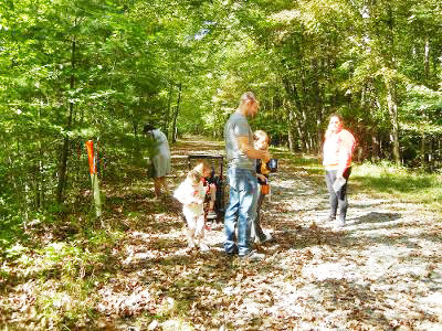 Parents helped their children hunt for colored leaves, grass, acorns, rocks, and other natural items along the picturesque rail trail, children painted and decorated pumpkins, played bowling and other games while parents visited the vendors and participated in raffles and 50/50's.