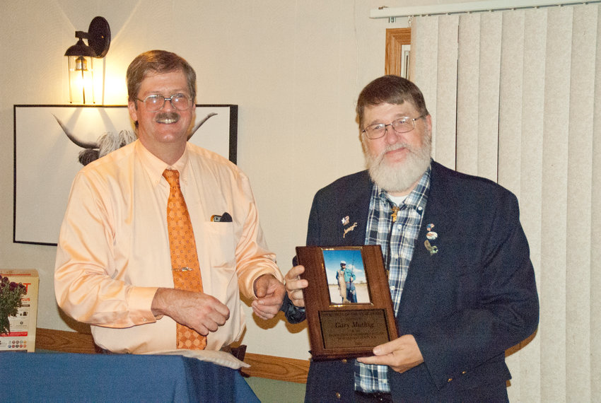Federation President John Van Etten (Left) presents Sportsman of the Year winner Gary Muthig with the award at their annual dinner at the Rockland House.