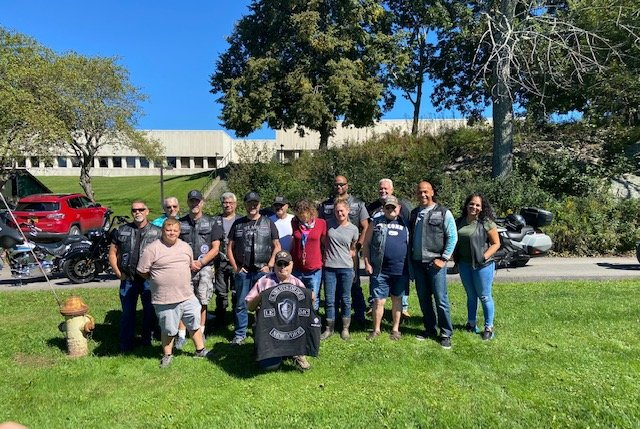 Members of the Knights Order Law Enforcement Motorcycle Club from Orange and Sullivan Counties and the Knights of Columbus from St. Peter's Church, in Monticello, joined the New Hope Community volunteers and staff at Hope Farm, to help harvest on the grounds of SUNY Sullivan.