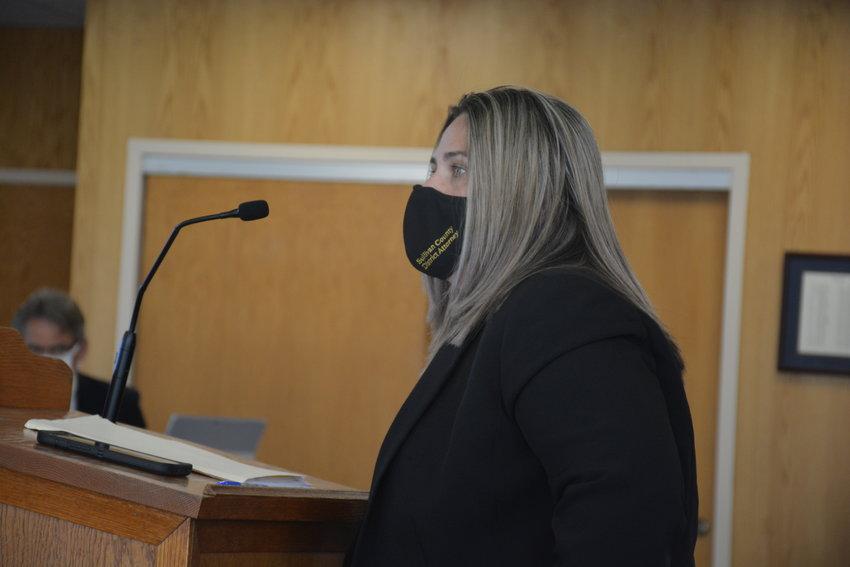 District Attorney Meagan Galligan addresses legislators.