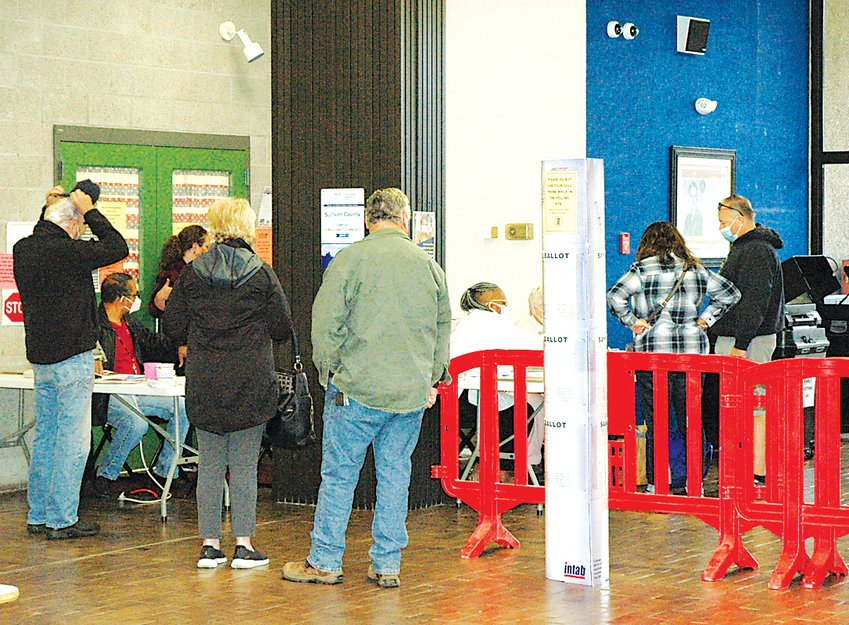 Voters preparing to enter the voting booths.