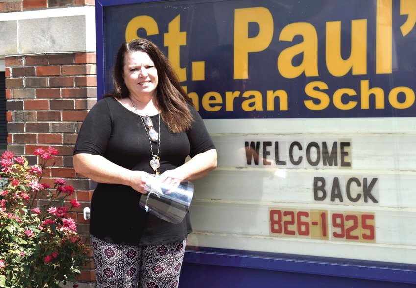Mary Walters stands outside St. Paul's Lutheran School in Sedalia on Wednesday afternoon. Walters is in her first year serving as principal of the private K-8 school. She returns to education following 25 years of classroom teaching and three years working as a substitute teacher.