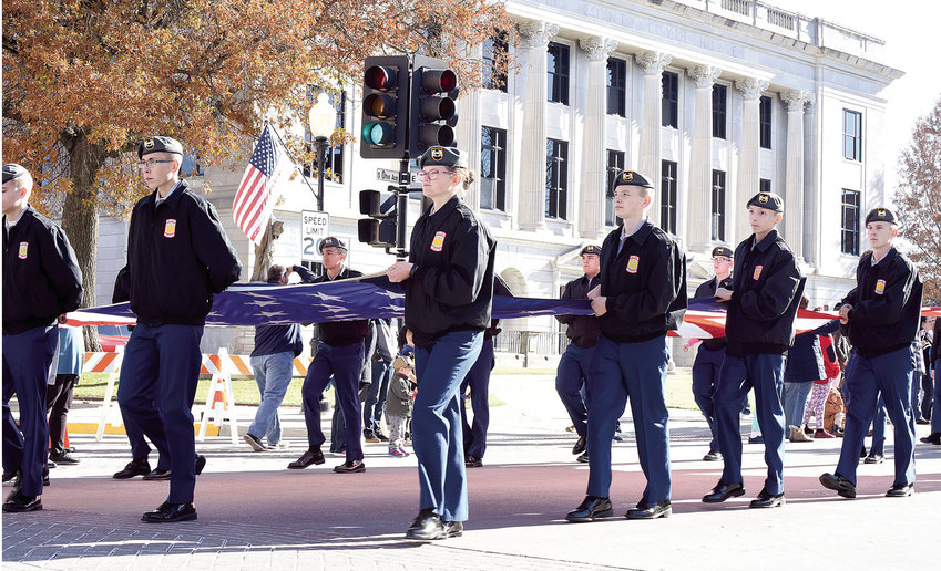 Smith-Cotton JROTC cadets carry the American Flag Saturday afternoon, Nov.  16, 2019, down Ohio Avenue during the annual Veterans Day Parade. The parade, hosted by the JROTC, was rescheduled from Nov. 11 to Saturday due to bad weather. Saturday's parade saw sunshine and mild temperatures.