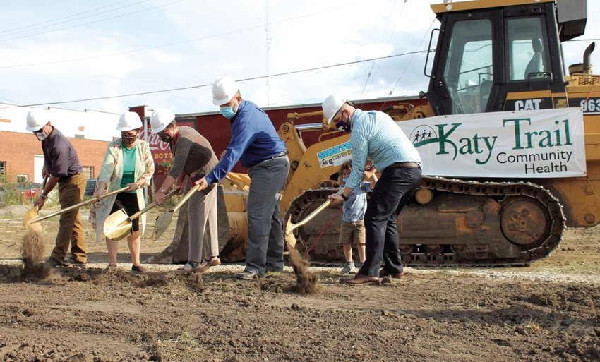 Local officials involved with the new Katy Trail Community Health location help kick off the project during Wednesday evening's groundbreaking ceremony hosted by the Sedalia Area Chamber of Commerce. The new site will be at 305 W. Main St.