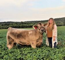 Dylan Deuschle stands with one of her crossbred steers on her parents' farm in rural Smithton. Deuschle will begin her senior year at Smithton on Aug. 26 has been exhibiting livestock since she was 5. She continued the tradition this year at the Missouri State Fair.