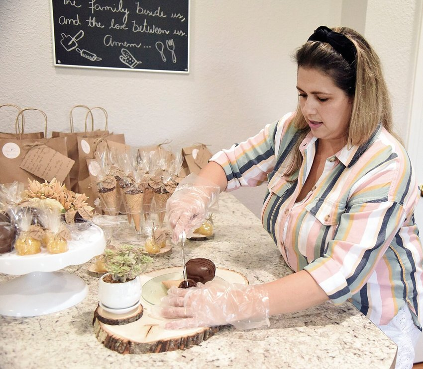 Alini Silva cuts a Brazilian truffle cone Thursday afternoon in her Sedalia home. Silva began a small business, The Pastry Home, last week that specializes in treats from the country of Brazil.