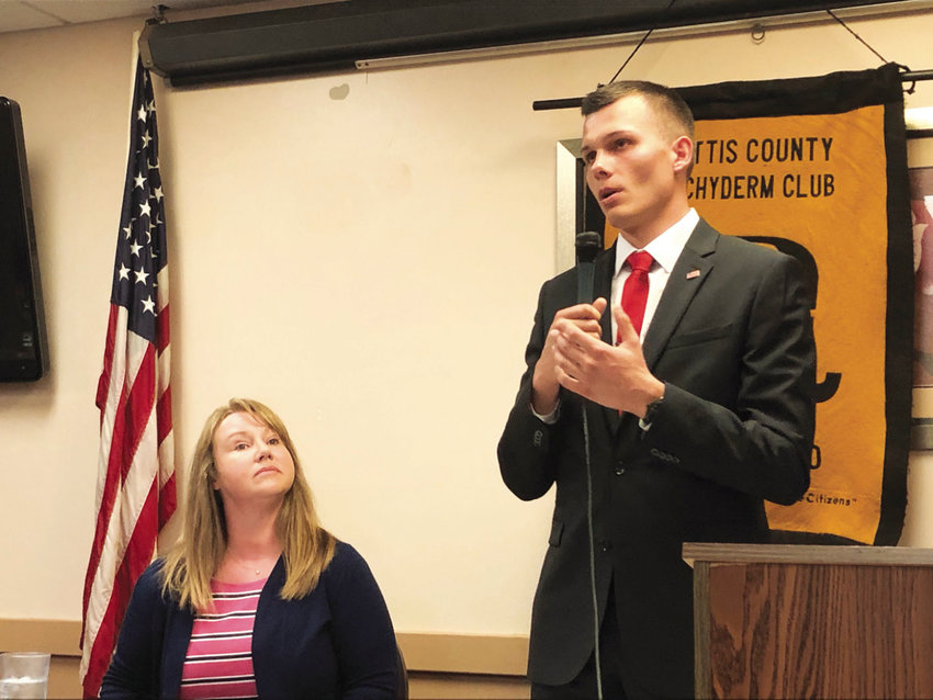 Pettis County Treasurer Kim Lyne, left, and candidate Vlad Warsawski, both Republicans, give their opening remarks during the Pettis County Pachyderm Club's forum for the upcoming Pettis County treasurer election.