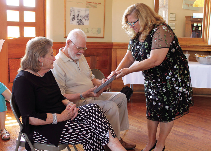 Sedalia Area Chamber of Commerce President Susan Mergen, right, presents the Outstanding Citizen Award to Robert and Barbara Hayden during the Chamber's annual awards ceremony Thursday at the Katy Depot.