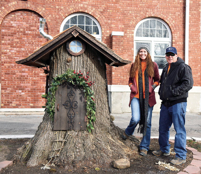 Sedalia Parks and Recreation Department Landscape Supervisor Shawna Yager and Maintenance Man Troy Meier stand beside the Fairy House Thursday morning at Liberty Park. The magical house was created by Yager, Meier and staff after a large Linden tree had to be cut down.