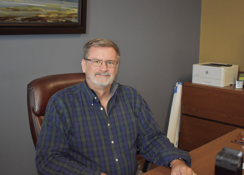 Rob Lamm sits at his desk inside his office at LammTech in Sedalia. The local IT firm started by Lamm is celebrating 20 years in 2019.