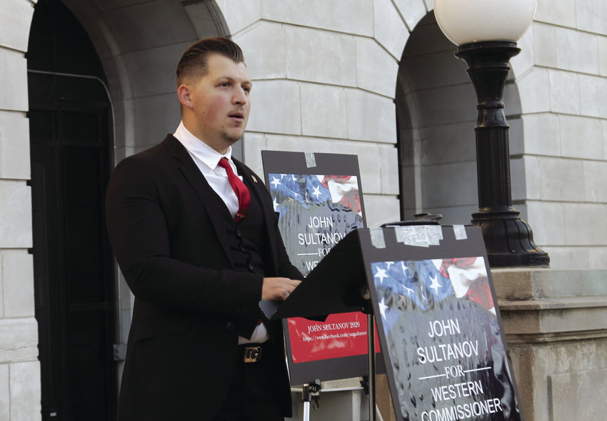 John Sultanov, 25, a Republican, announces he is running for Pettis County Western Commissioner in 2020 during his campaign announcement Thursday evening outside the Pettis County Courthouse.