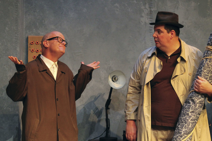 """During a rehearsal last Thursday at the Liberty Center, Chris Clark, left, talks with John Hopper about his plan to con a blind woman while trying to get an important item from her Greenwich Village apartment. """"Wait Until Dark"""" will be performed Friday, Saturday and Sunday."""