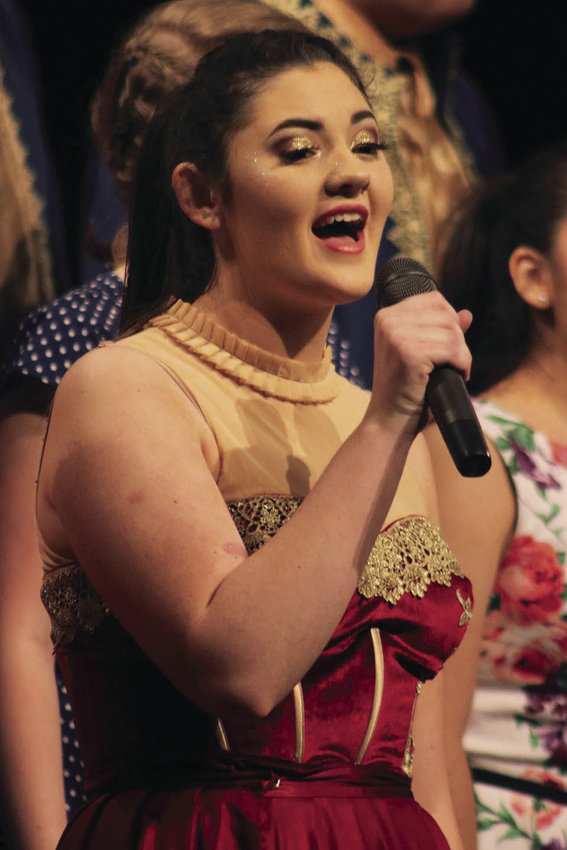 Cora Sadler performs at the close of the Smith-Cotton vocal music department's Senior Farewell Vocal Music Concert in the Heckart Performing Arts Center. Sadler has been selected to the Missouri All-State Show Choir for the second year in a row.