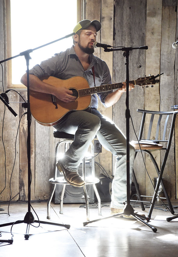 Matthew Cozart, of Odessa, performs at Von Holten Ranch, near Mora, Saturday night. After a ribbon cutting for the new Mountain Trail Course, the ranch hosted a bluegrass festival. Cozart will open at the ranch for Leroy VanDyke in October.