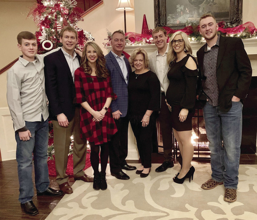 Pictured are members of the Weymuth family, owners of the W-K Family of Dealerships, at a Christmas party at the Sedalia Country Club. From left, Karson, Kyle and his wife Kelli, Ken and Kim, Kelsey and his wife Ashley, and Kendall.