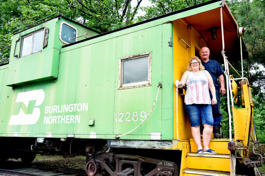 On Wednesday, Rick and Diane Fosnow stand on the steps of one of two cabooses they now own and operate as a bed and breakfast near Calhoun. Cruse's Cabooses, formerly owned by Damon Cruse, was purchased by the couple last year after Cruse's untimely death.