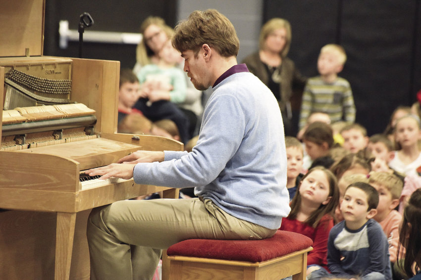 Scott Joplin International Ragtime Foundation Artist-in-Residence William McNally plays a ragtime tune in February for students at Parkview Elementary School. McNally, of New Braunfels, Texas, spent the week performing at different elementary schools. Proceeds from the Scott Joplin International Ragtime Festival are used to help fund the program.