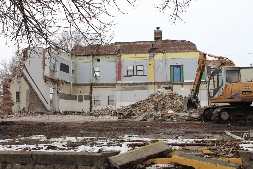 Only a portion of the Sedalia Community Center on South Washington Avenue remains Thursday afternoon after crews have worked to demolish it over the past week. The site will be home to two new apartment complexes later this year.
