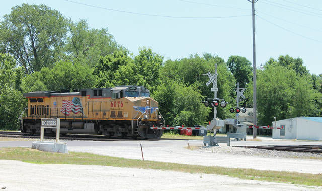 A Union Pacific train engine goes past the railroad crossing at Engineer Street near Third Street during an Operation Lifesaver railroad crossing enforcement program in 2016.