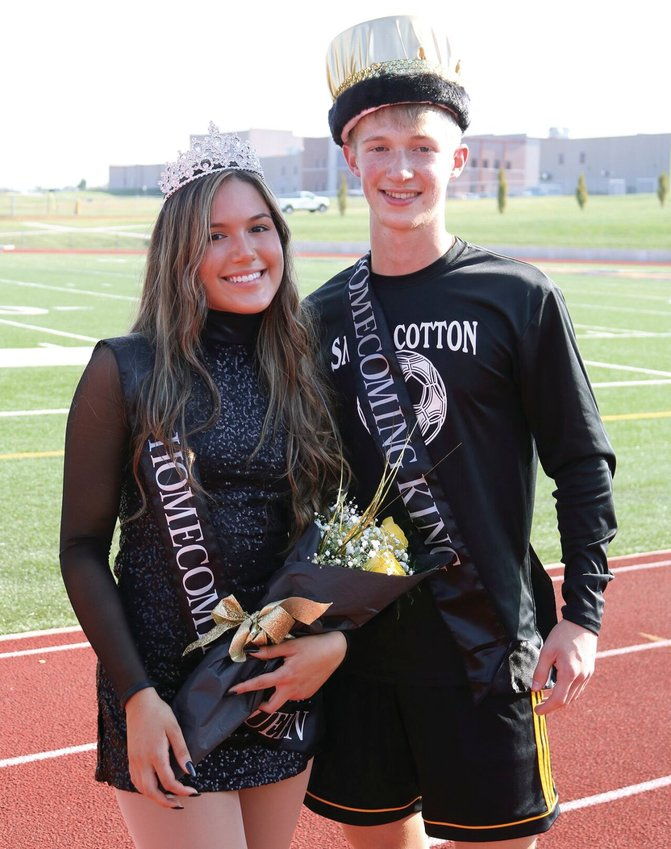 During the Smith-Cotton High Homecoming pep assembly on Friday, Oct. 9, senior Envie Johnson, left, was named Homecoming queen and senior Austyn Wenner was crowned Homecoming king. Princess, not shown, was Olivia Poteet. Student votes determined the winners.