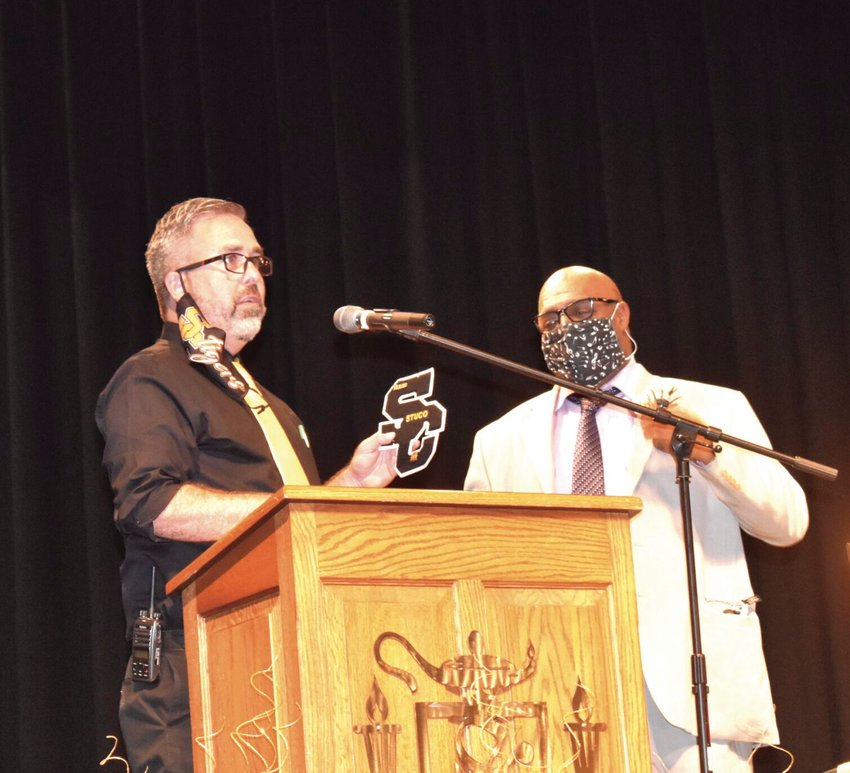 Smith-Cotton High School Principal Wade Norton presents an S-C letter to 2020 Sedalia School District Foundation Distinguished Alumni recipient Arthurr W. Seabury Jr. at the Heckart Center for the Performing Arts Friday afternoon. Decades after being falsely accused of a crime, Seabury was given back his titles and awards on Friday during the Distinguished Alumni Award ceremony.