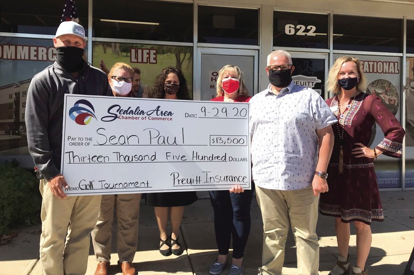 Members of the Sedalia Area Chamber of Commerce and Preuitt Insurance presented Sean Paul with a $13,500 check Sept. 29 for making the Hole-N-One. The Chamber hosted the annual golf tournament in August at the Sedalia Country Club.