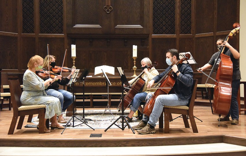 Sedalia Symphony Conductor Luke Lyons practices with a chamber string quartet Monday night at First United Methodist Church. The first concert of the 86th season will open as a virtual chamber music performance due to the COVID-19 pandemic.