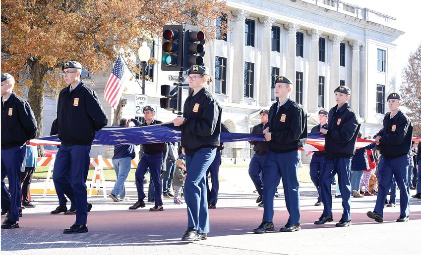 Smith-Cotton JROTC cadets carry the American flag Saturday, Nov. 16, 2019, down Ohio Avenue during the annual Veterans Day Parade. The 2020 parade has been canceled due to the pandemic.