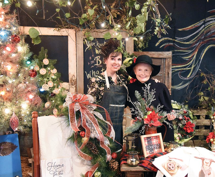 Tiffany Bryant, left, and her mother, Linda Hazell, stand amid a display of holiday gifts and decorations at their business, Horseshoe Hill Barn Market, Thursday afternoon. The business opened in October and is a marketplace for one-of-a-kind antiques as well as food, jewelry and gift items from a number of vendors from across the state.