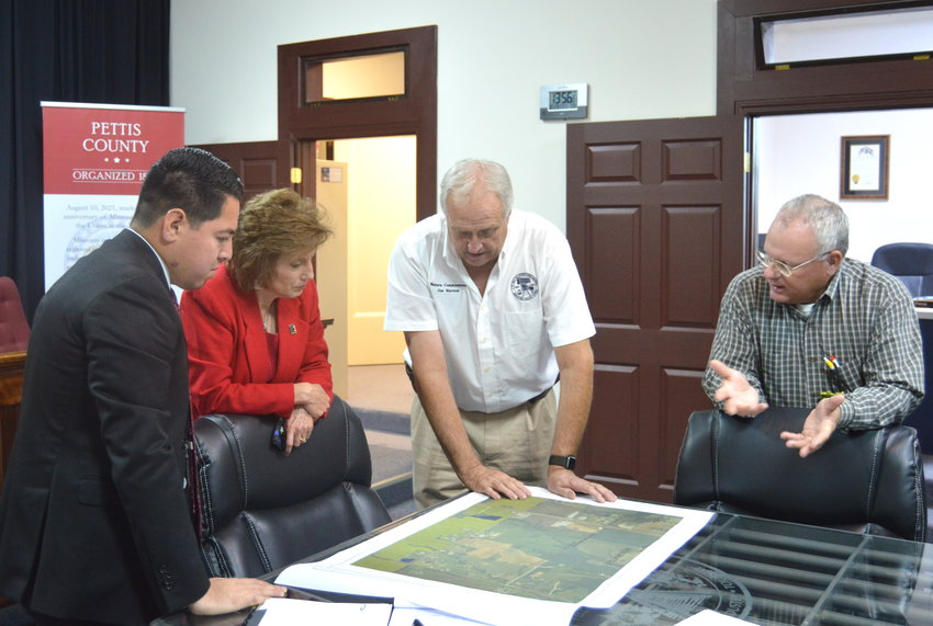 From left, Pettis County Eastern Commissioner Israel Baeza, U.S. Rep. Vicky Hartzler, R-District 4, Western Commissioner Jim Marcum and Presiding Commissioner David Dick discuss the Pettis County U.S. Route 65 overpass project at the Pettis County Courthouse on Friday afternoon.