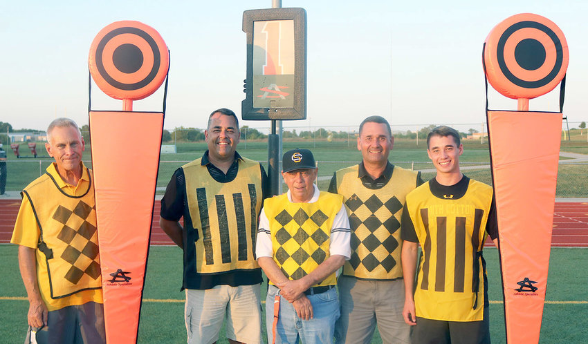 The chain gang that works Smith-Cotton Tigers home football games is, from left, Bob Williams, and three generations of the Matz family: Craig, Chuck, Scott and Andrew Matz.