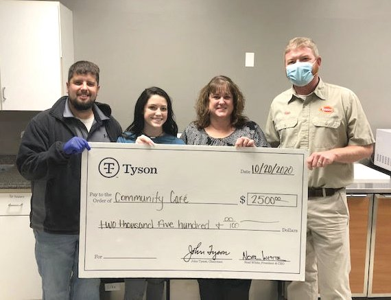 Tyson Foods presented the Community Café with a $2,500 check Oct. 19. The funds will be used to continue distributing evening meals to the food insecure in the Pettis County area. Meals are served from 5 to 5:45 pm Monday through Friday at the Open Door North Venue. Pictured from left are Jay Lutjen, Sedalia School District 200 representative; Abby Bruce, student executive director; Jenie Bruce, Community Café board president; and Alan Johnston, Tyson Complex manager.