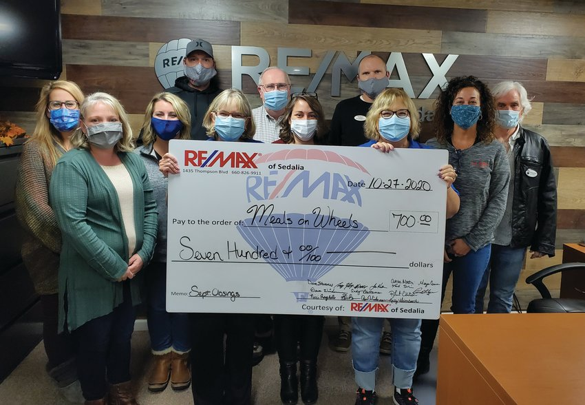 RE/MAX of Sedalia recently donated $700 to Meals on Wheels through its Heart of Sedalia Foundation. Each month, the agents donate a portion of their earnings from every transaction to help support various local charities. Pictured are Dave Wiedeman, Ryan Wiedeman, Billie Barnes, Robert Ekstrom, Angie Yeager, Nicci Ragsdale, Dennis Hagen, Misty Inlow and Ashlee Martin.