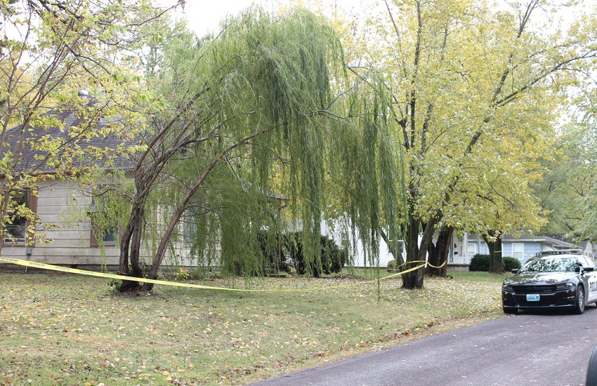 Caution tape surrounds a residence in the 1700 block of South Harrison Avenue as the Sedalia Police Department investigates the suspicious death of two males inside the home Thursday, Oct. 29.