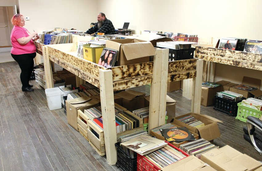 Deana Taylor, left, and James Harmon sort through records Thursday night in their new store, Jammin' Nuggets Music, at 115 S. Ohio Ave. The business is set to open this weekend.