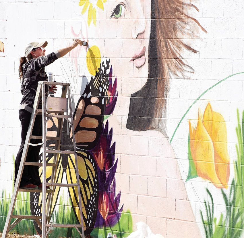 Earlier this week, Sedalia artist Stefanie Aziere-Sattler works on a mural she's creating for Wildflower Beauty Co. at Seventh Street and South Ohio Avenue. Wildflower Beauty Co. is planning to make a hashtag for the mural and donate to the Boys & Girls Clubs of West Central Missouri. Aziere-Sattler is donating her time and material for the mural project.