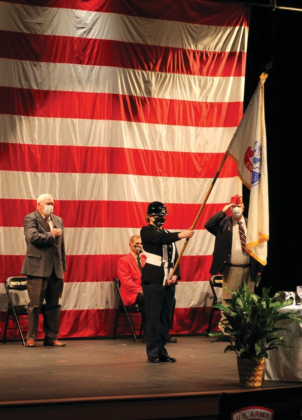 Don Barbour, of the 40&8 veterans organization, left, and Paul Bennett, of American Legion Post 642, stand for the U.S. Army flag held by a Smith-Cotton High School JROTC cadet during the recognition of military branches at the Veterans Day ceremony hosted at SCHS Wednesday morning.