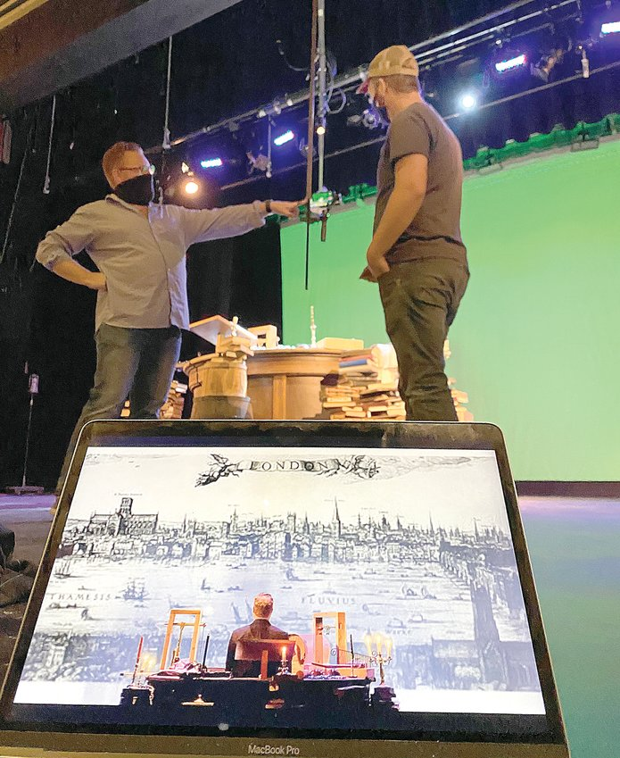 "Arrow Rock Lyceum Theatre Producing Artistic Director Quin Gresham, left, and Resident Scenic Designer Ryan J. Zirngibl troubleshoot technical aspects of a digital media production. In the foreground is a partially-edited test shot. The Lyceum will present an online version of Charles Dickens' ""A Christmas Carol"" Dec. 22 and 23."