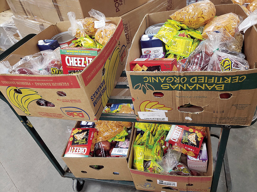 Boxes of food at Open Door Pantry wait to be placed into vehicles Monday, April 6.
