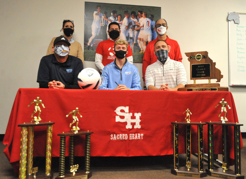 Gremlins senior Lucas Martin, front and center, poses for a photo Tuesday after signing a National Letter of Intent to play soccer at State Fair Community College during a signing event at Sacred Heart School. Lucas Martin is joined in the front row, from left, by State Fair Community College soccer head coach Jaime Beltran, and Sacred Heart soccer coach Sam Jones and, in the back row, Sacred Heart athletic director Amanda Blackburn, Gremlins assistant coaches Israel Baeza and Richard Bahner.