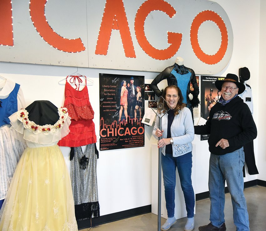 "Tuesday afternoon, Kathleen and Greg Boswell ham it up as they stand beside props from the Hayden Liberty Center musical ""Chicago."" Greg directed the play and Kathleen played the emcee in the production. An exhibit, ""The Show Must Go On 100th Anniversary Exhibit,"" is now open and celebrates the history of the Liberty Center Association for the Arts theatre and art shows."