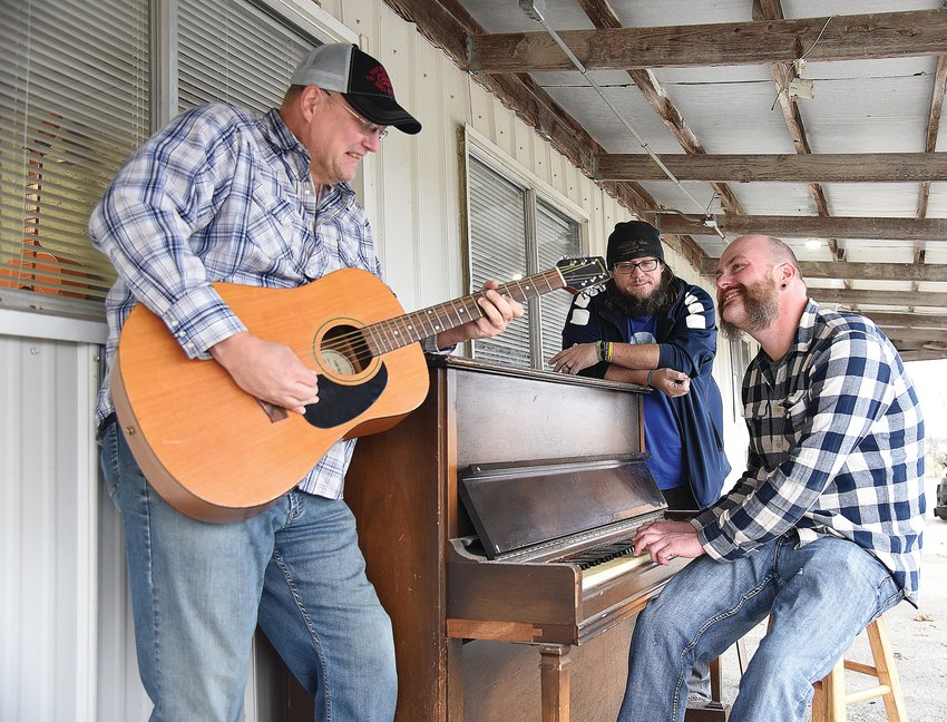 """Members of the blues band Cold Trigger have a jam session outside the Making the Band Studio Thursday morning. From left are Kevin Wilson, Justin Lawson and Patrick Monahan. The men have just released a 10-song blues album, """"Mo Blues Please,"""" that is available on 150 media platforms."""