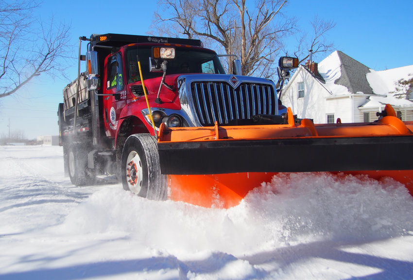 One of nine city plows clears West Cooper Street on Tuesday morning as crews work around the clock this week. More snow is expected overnight into Wednesday.