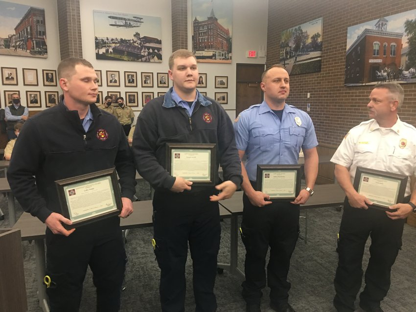 Sedalia firefighters were commended during Monday night's Sedalia City Council meeting in the Sedalia Municipal Building for their heroics in the Feb. 11 fire at a residence on Third Street. From left, firefighters Colby Snapp, Joe Arnold, Alex Razumovsky and Capt. Greg Smith.