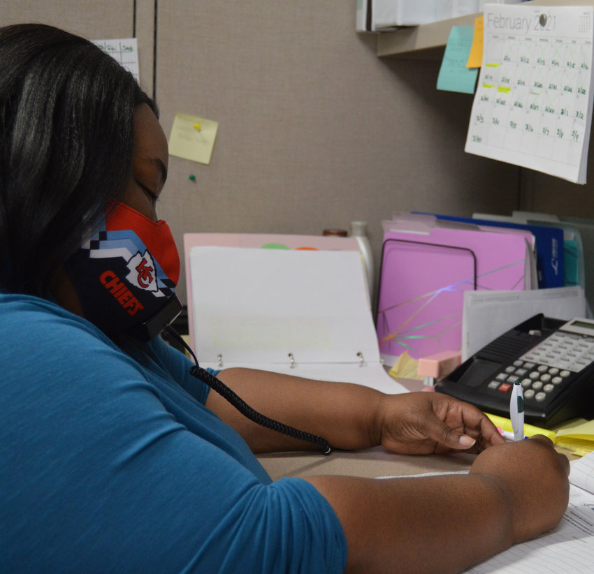 Vanessa Edwards, a contact tracer at the Pettis County Health Center, fills out a form while talking to a citizen in February. The Health Center is seeing fewer cases of COVID than during the pandemic's peak in November due to vaccinations, quarantining and contact tracing.