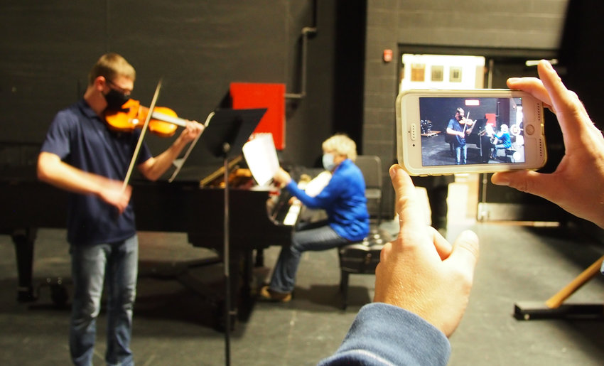 Violin student Caleb Ehlers performs for the State Music Festival online Friday with accompanist Cheryl McCollester at Smith-Cotton High School.